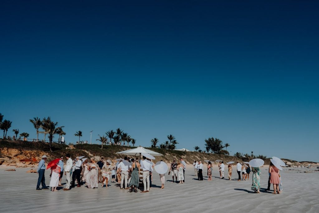 wedding guests are mingling on Cable Beach