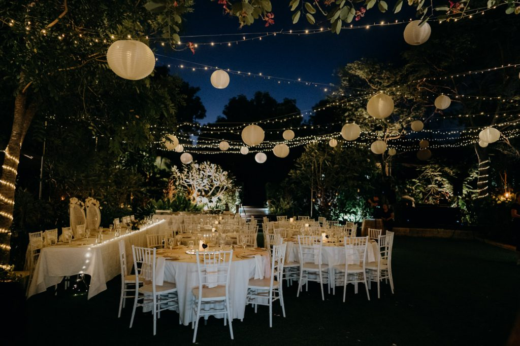 outdoor wedding reception with fairy lights and lanterns at Billi Resort