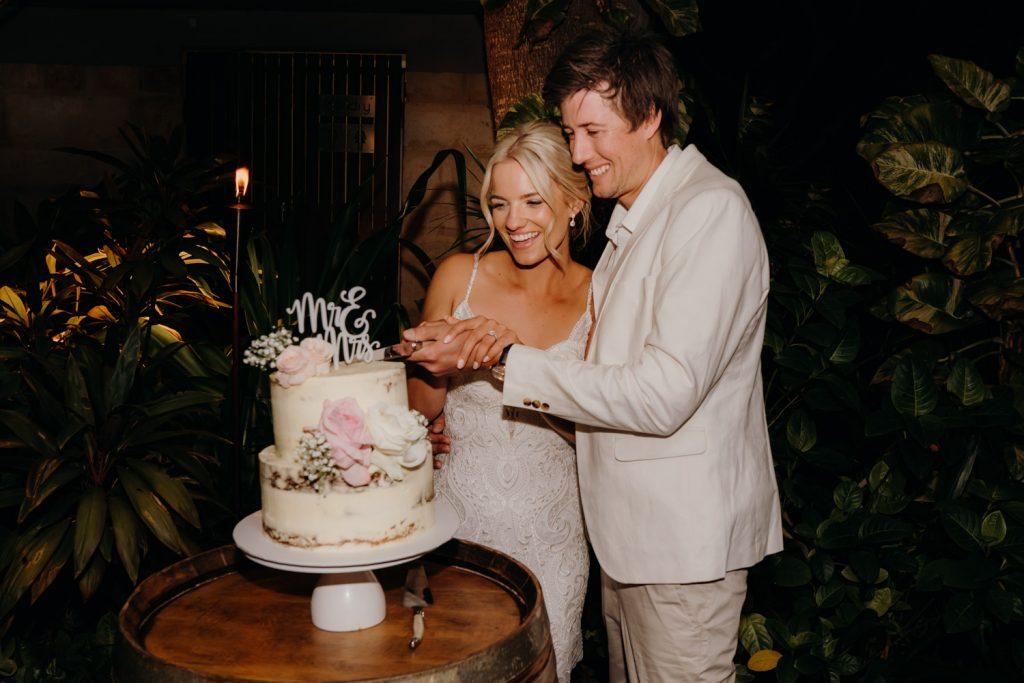 wedding couple cuts cake