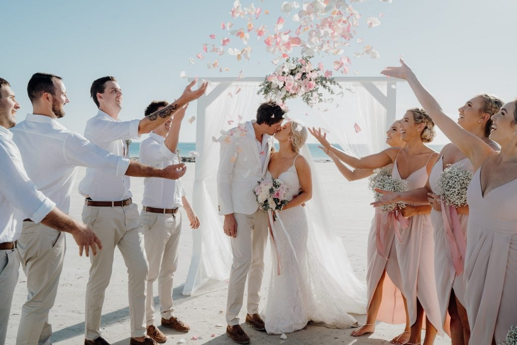 bridal party showers Cable Beach wedding couple in rose petals