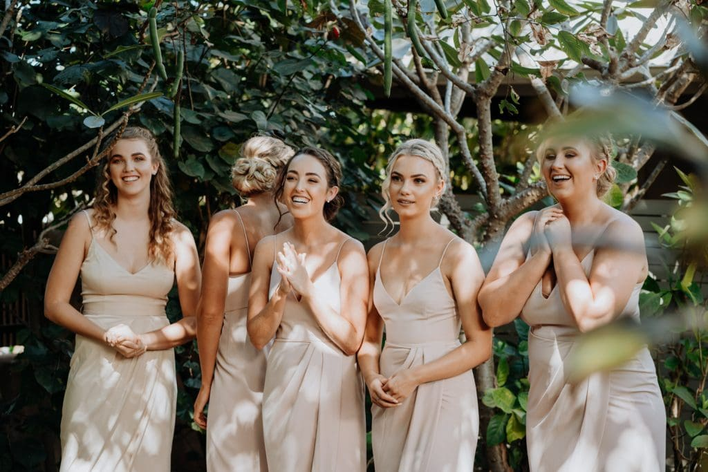 emotional bridesmaids during a first look of the bride in her dress