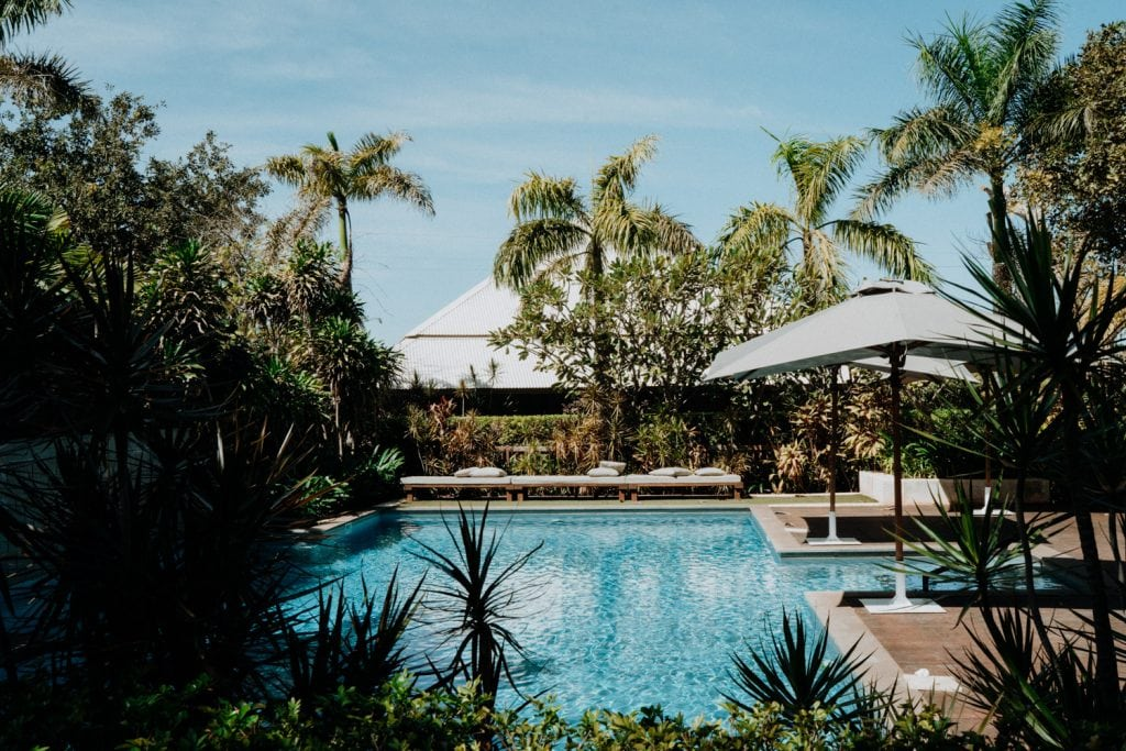 swimming pool surrounded by palm trees at Billi Resort in Broome