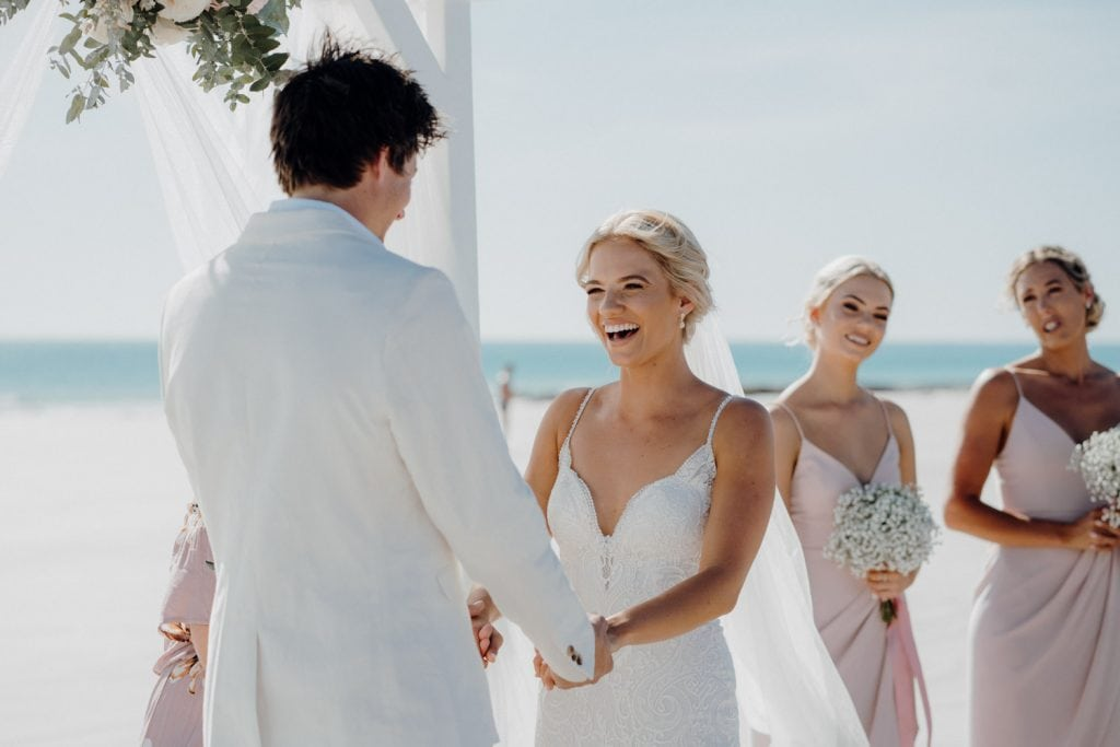 smiling bride during wedding ceremony on the beach