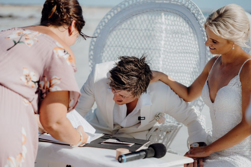 the signing of the marriage certificate on Cable Beach