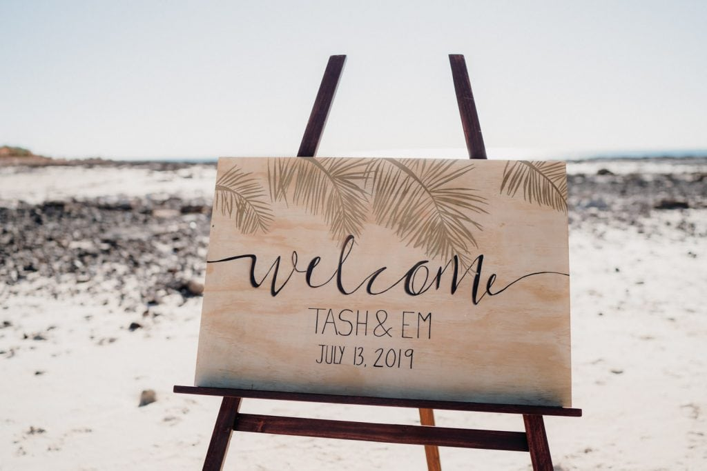 wooden welcome sign at Em and Tash's Cable Beach wedding in Broome