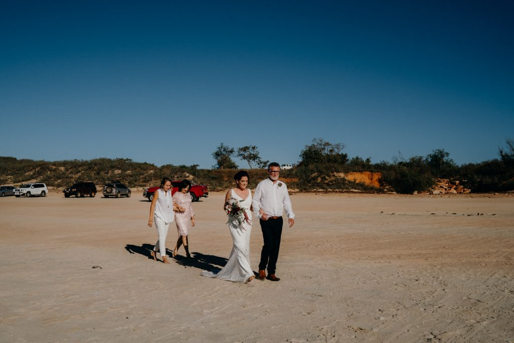 Cable Beach same sex wedding with two brides walking down the aisle