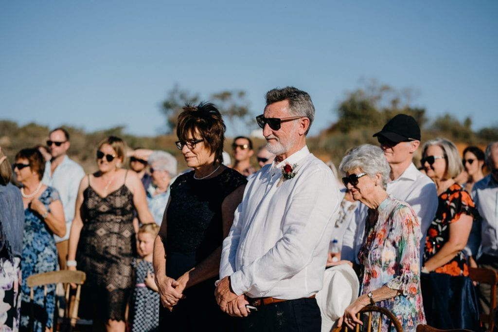 wedding guests standing and watching Cable Beach wedding ceremony