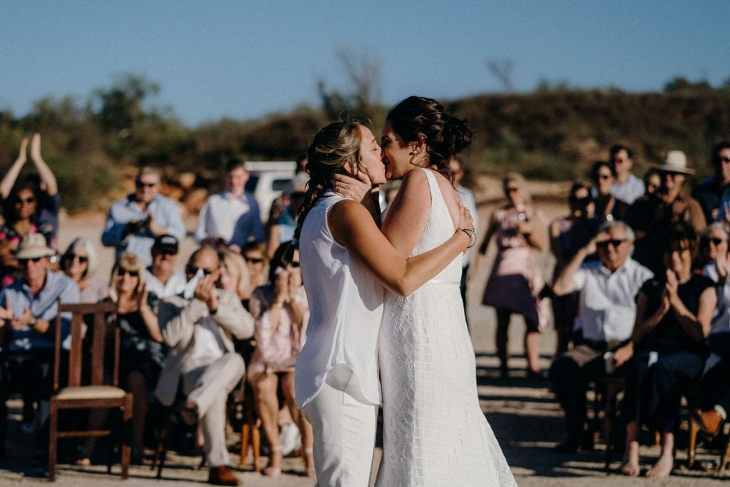 two women kissing at their Cable Beach wedding in Broome Western Australia