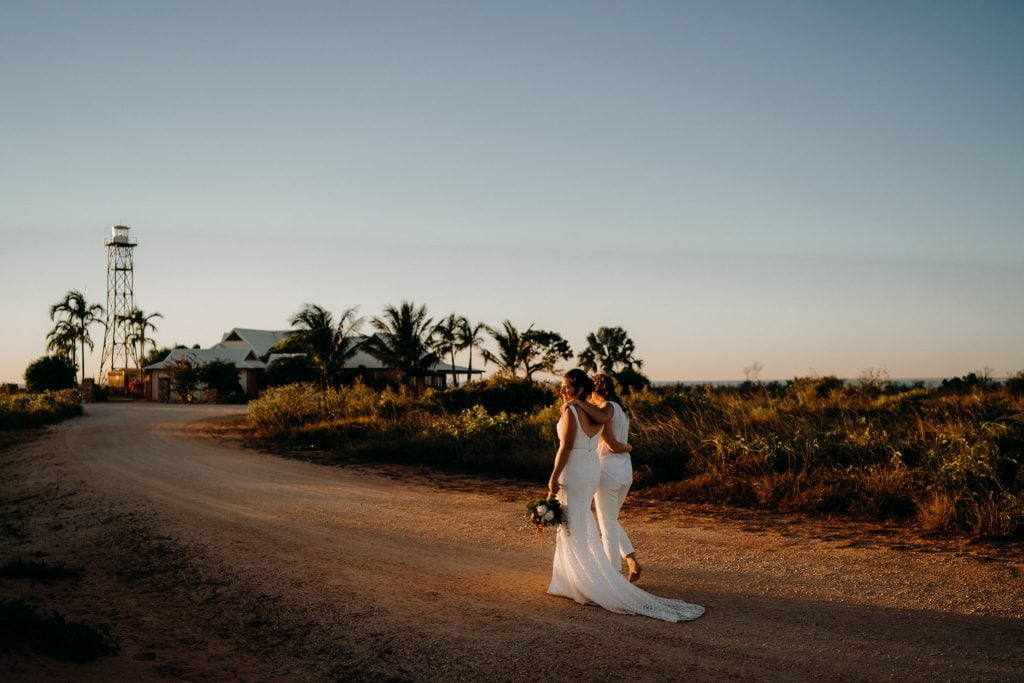 Cable Beach wedding couple walking along on dirt road