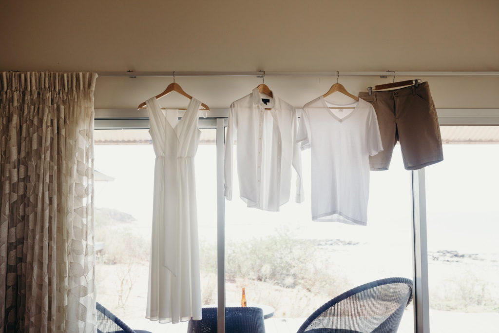 wedding clothes hanging on hangers in Eco Beach villa