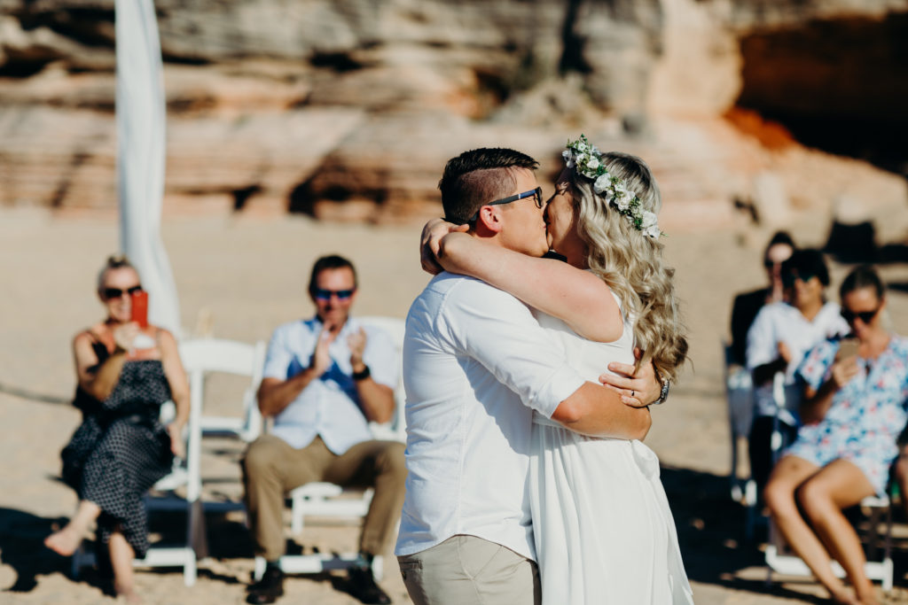 two women kissing at their wedding ceremony at Eco Beach wedding