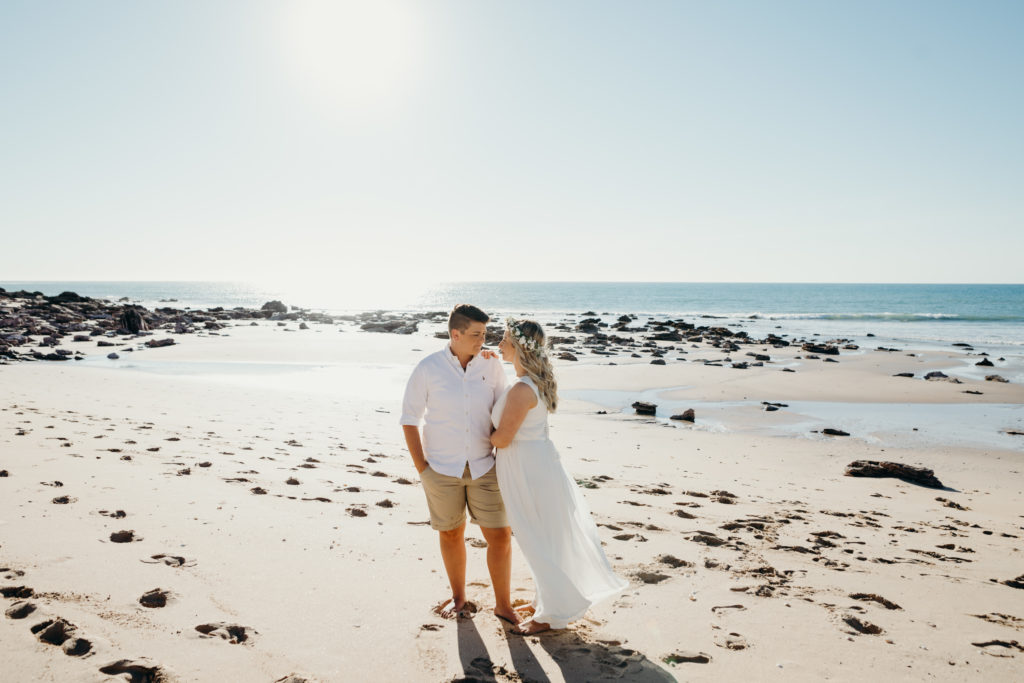 young married same sex couple standing on Eco Beach
