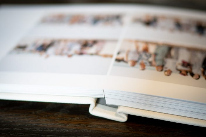 lay flat wedding book with white leather cover