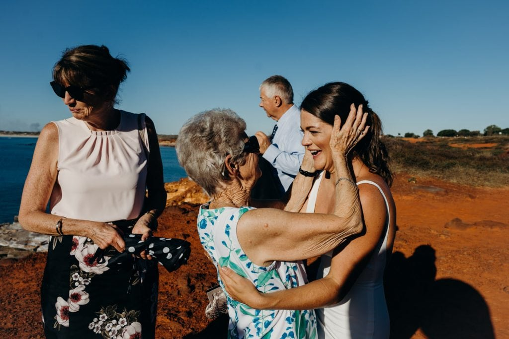 grandmother congratulates young bride at Gantheaume Point wedding in Broome