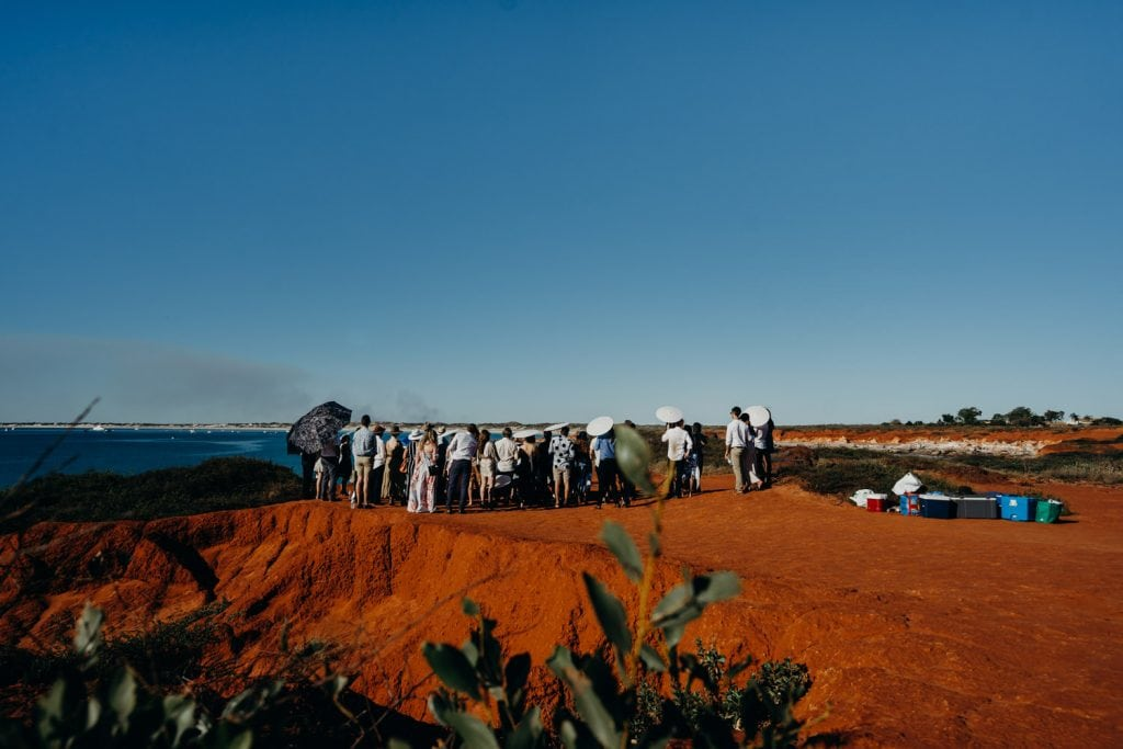 wide shot of a cliff top wedding at Gantheaume Point in Broome Western Australia