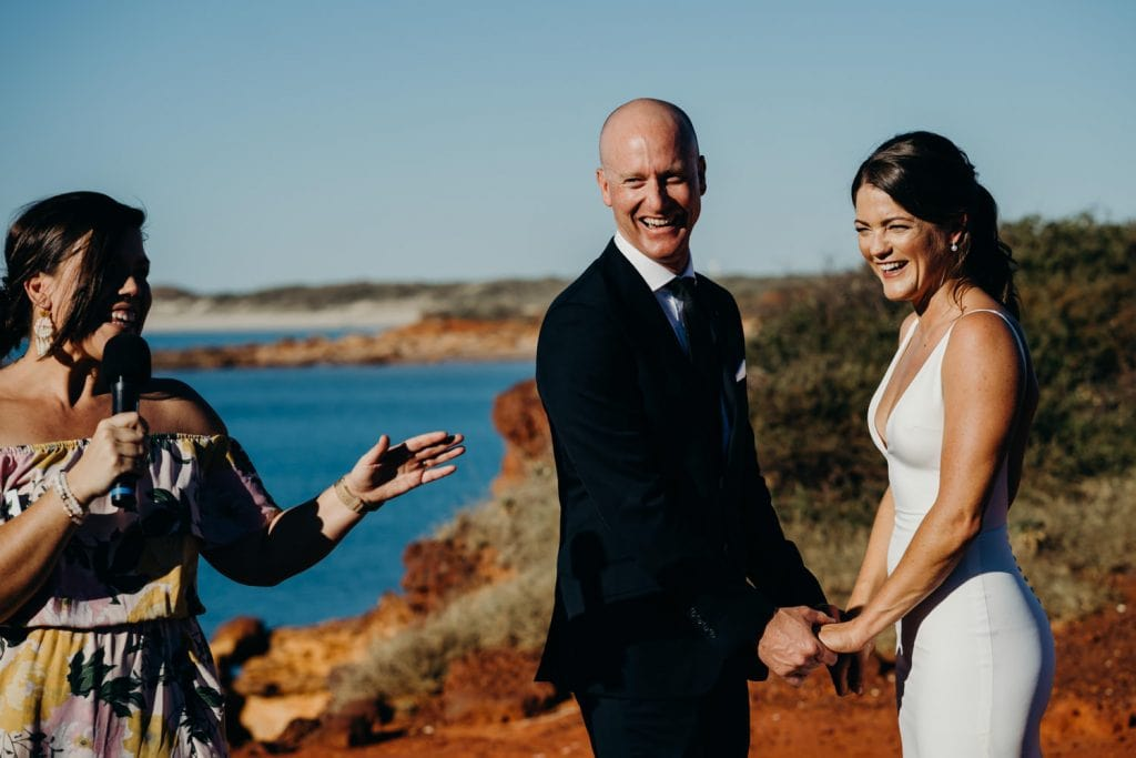 bride and groom with Broome marriage celebrant Elle Saunders at Gantheaume Point