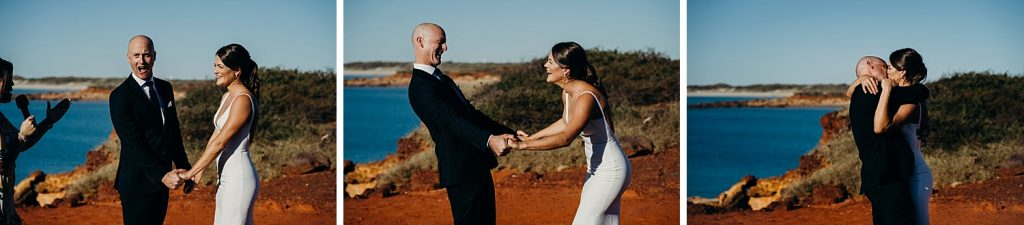 bride and groom kissing during their wedding ceremony at Gantheaume Point in Broome