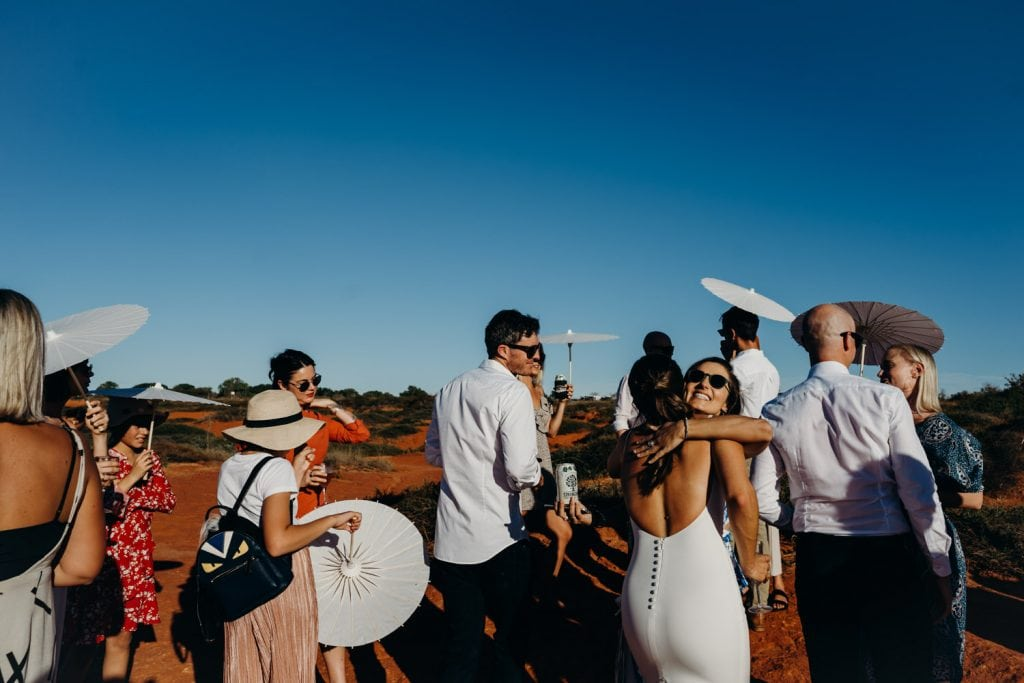 friends of the wedding couple congratulating the newly weds in Broome Western Australia