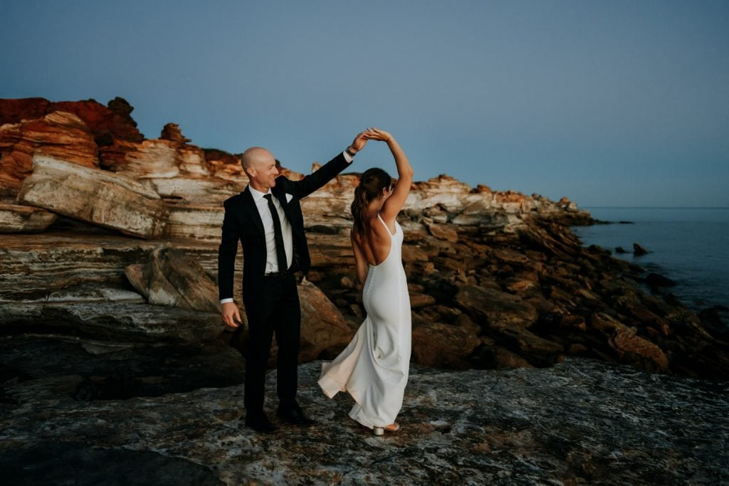 wedding couple dance on large flat rock at Gantheaume Point in Broome