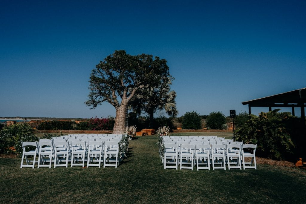 set up of chairs in front of boab tree at Gnarangannie Gantheaume Point wedding
