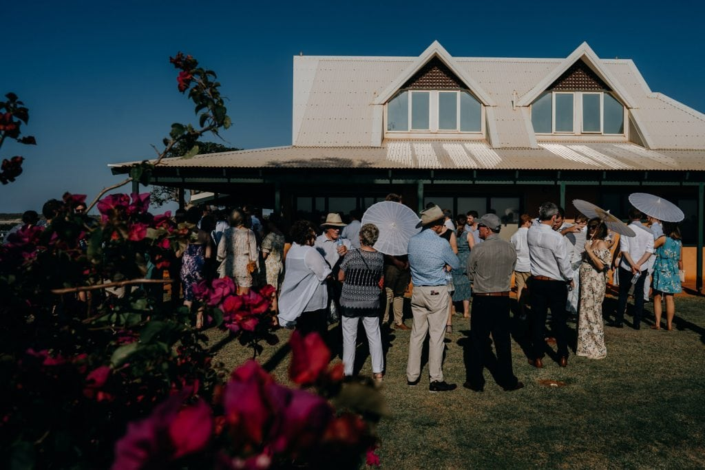 wedding guests mingling at house at Gantheaume Point called Gnarangannie