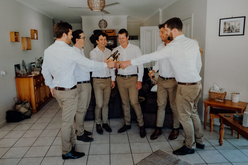 groom and his groomsmen having beers at house