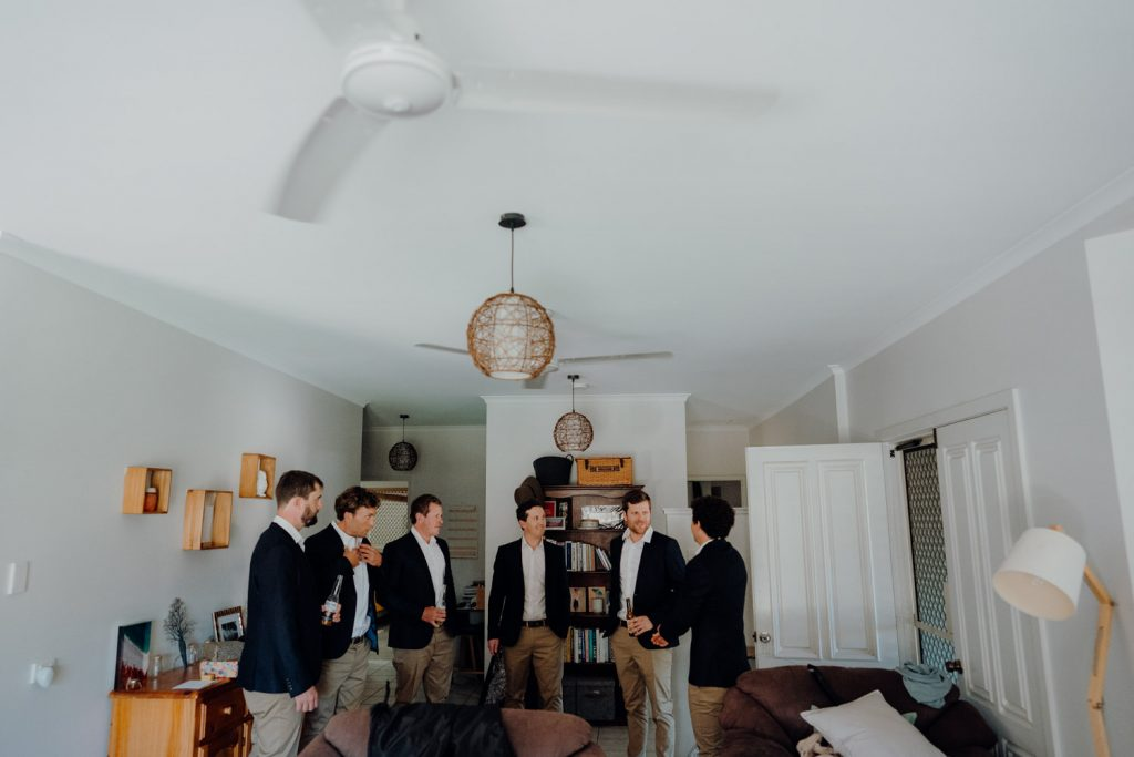 groom and groomsmen getting into their jacket for Gnarangannie wedding