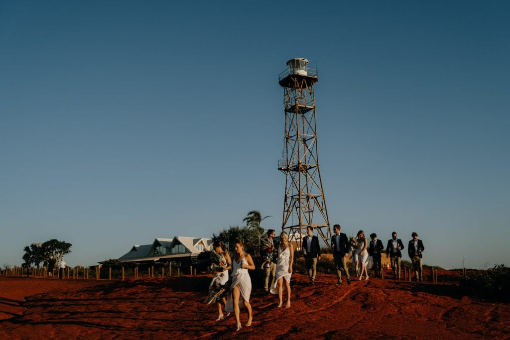 bridal party walking past the lighthouse near Gnarangannie at Gantheaume Point