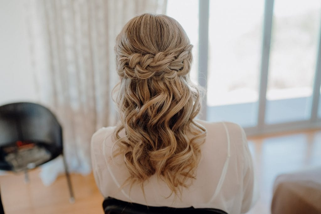bridal hair style by Bonnie Louise for helicopter elopement at Eco Beach