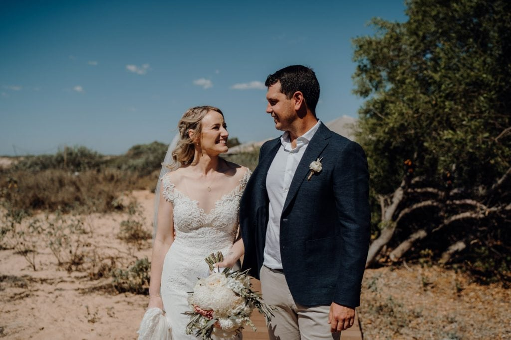 young wedding couple looking at each other in sunny Australia