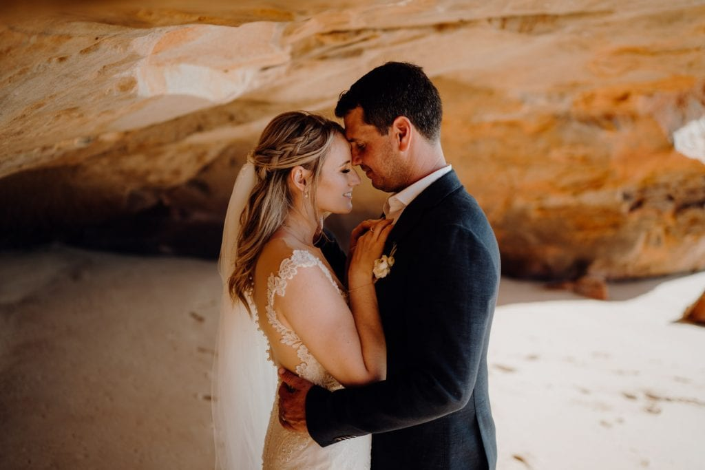 elopement at Eco Beach with couple inside cave