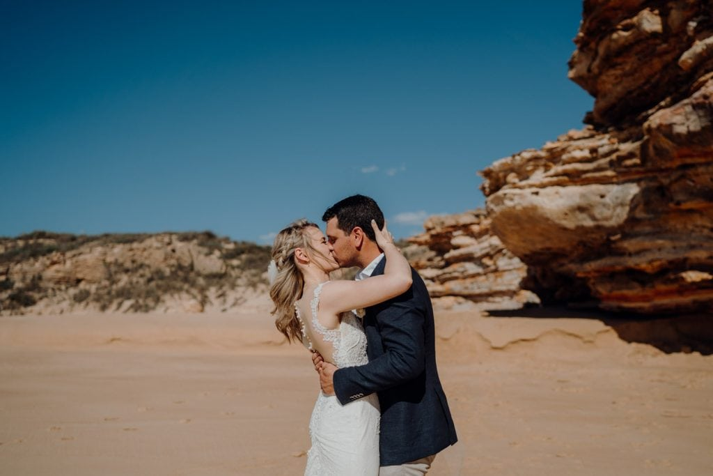 first kiss at elopement at Eco Beach