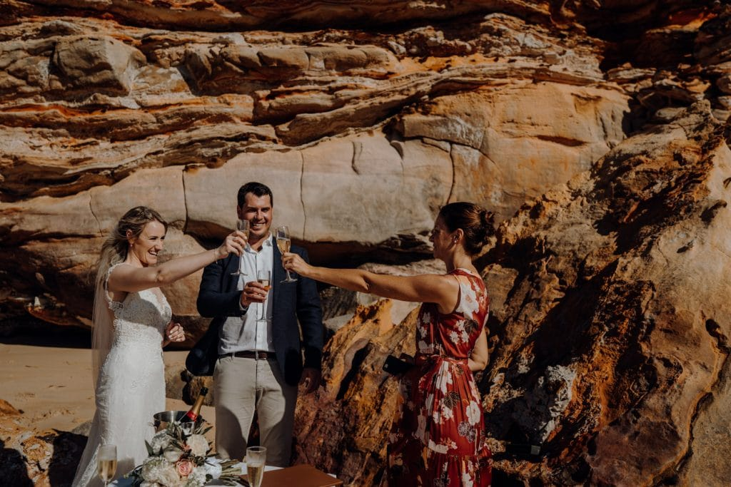 champagne toast with celebrant to celebrate elopement at Eco Beach