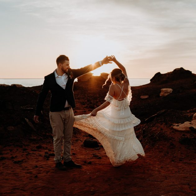 elopement wedding couple twirling at sunset