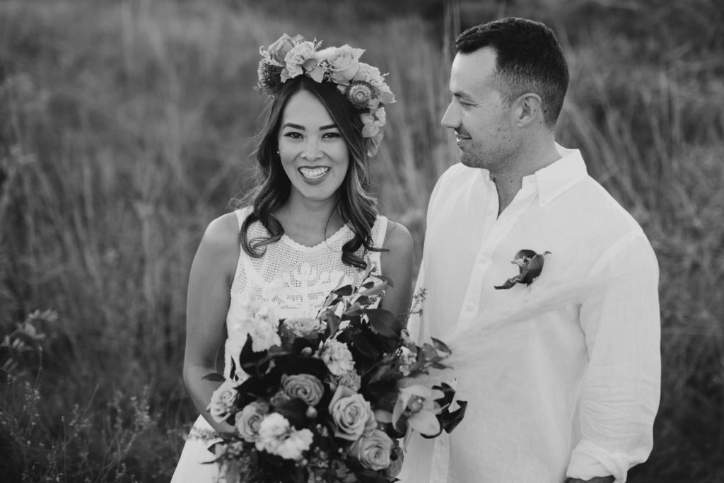 boho Kimberley bride in Zolotas Australia gown with groom in white shirt looking at her