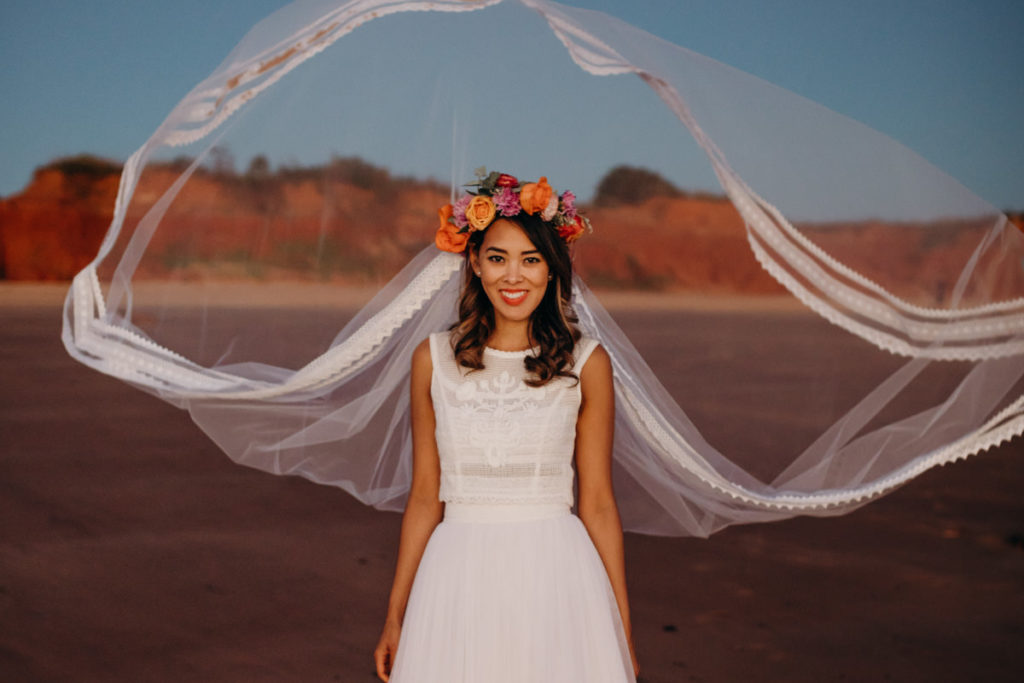 bride in Zoloatas Australia dress and long veil with veil moving in the wind