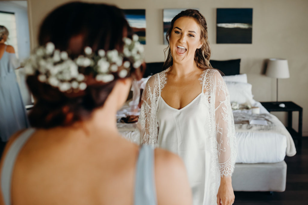 bride to be in getting ready robe at Billi Resort