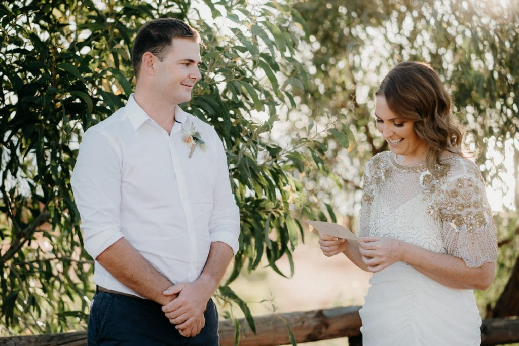 couple shares wedding vows at Kooljaman Resort at Cape Leveque elopement