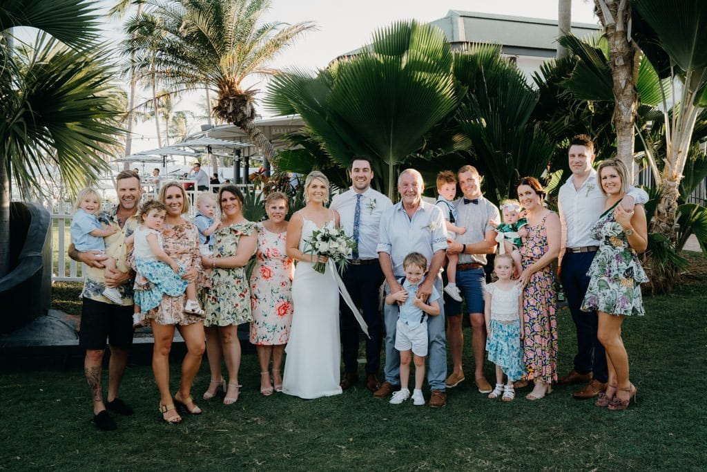 family photo at wedding with extended family members all looking at the camera at the Mangrove Hotel in Broome