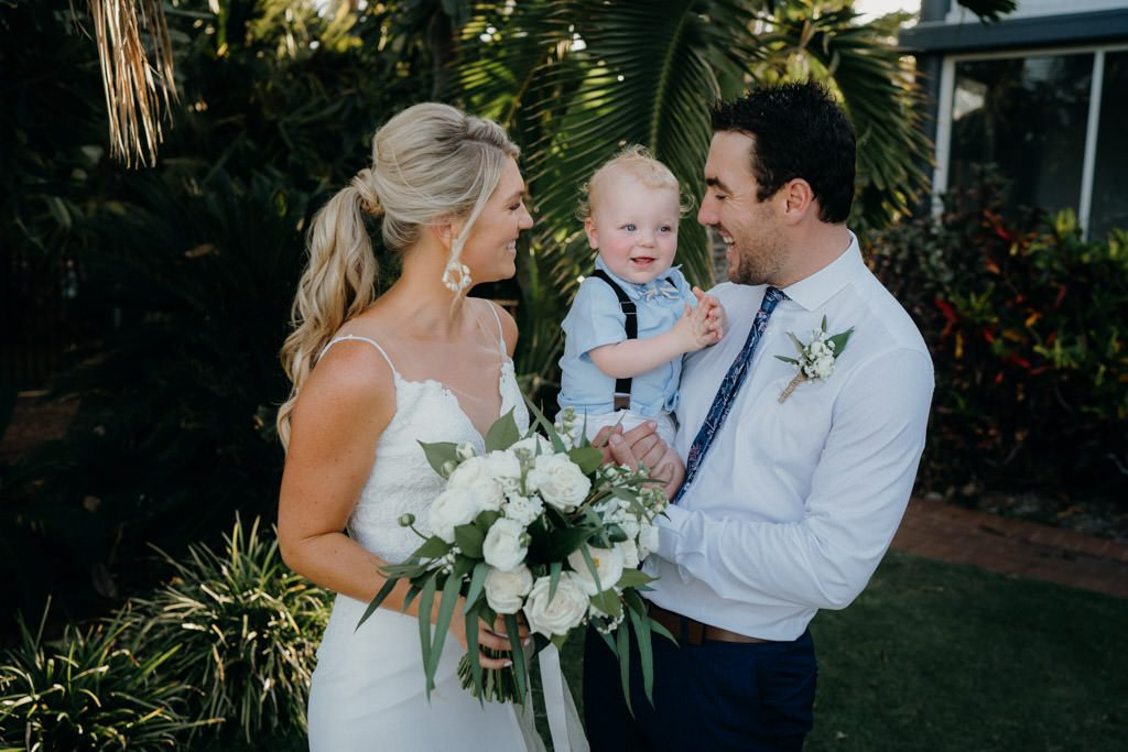 bride and groom with their young son in their arms at Mangrove Hotel in Broome
