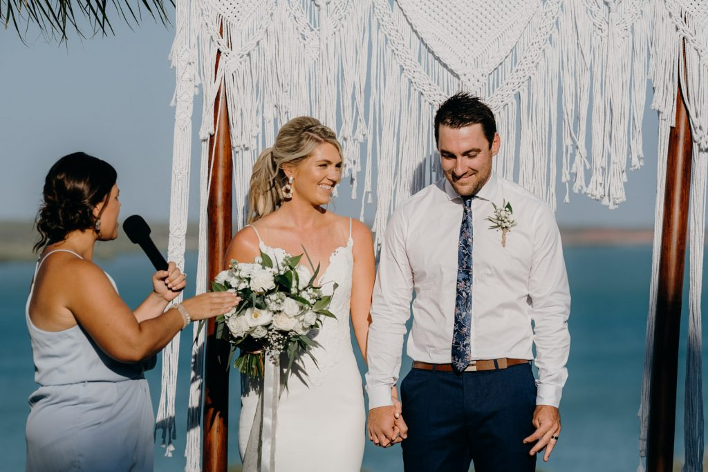 wedding couple at Mangrove Hotel in Broome with celebrant announcing them as husband and wife