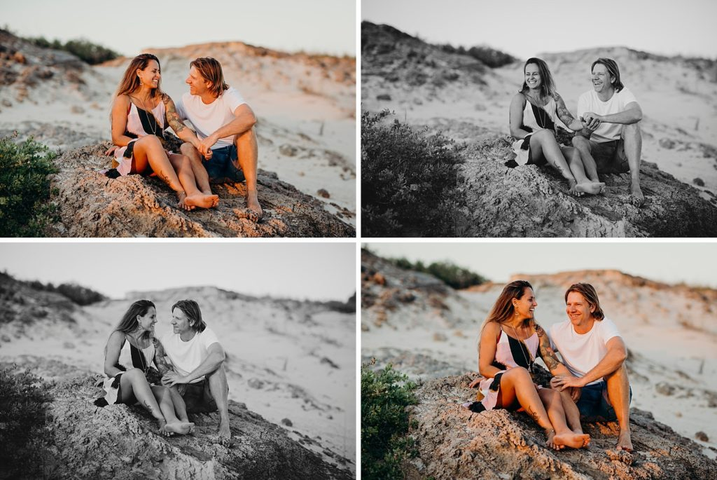 laughing couple sitting in the Cable Beach dunes in Broome