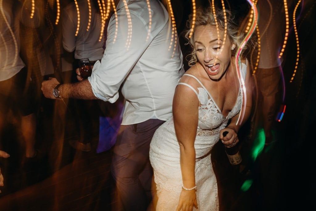 bride in wedding dress dancing at the Mangrove Hotel wedding in Broome