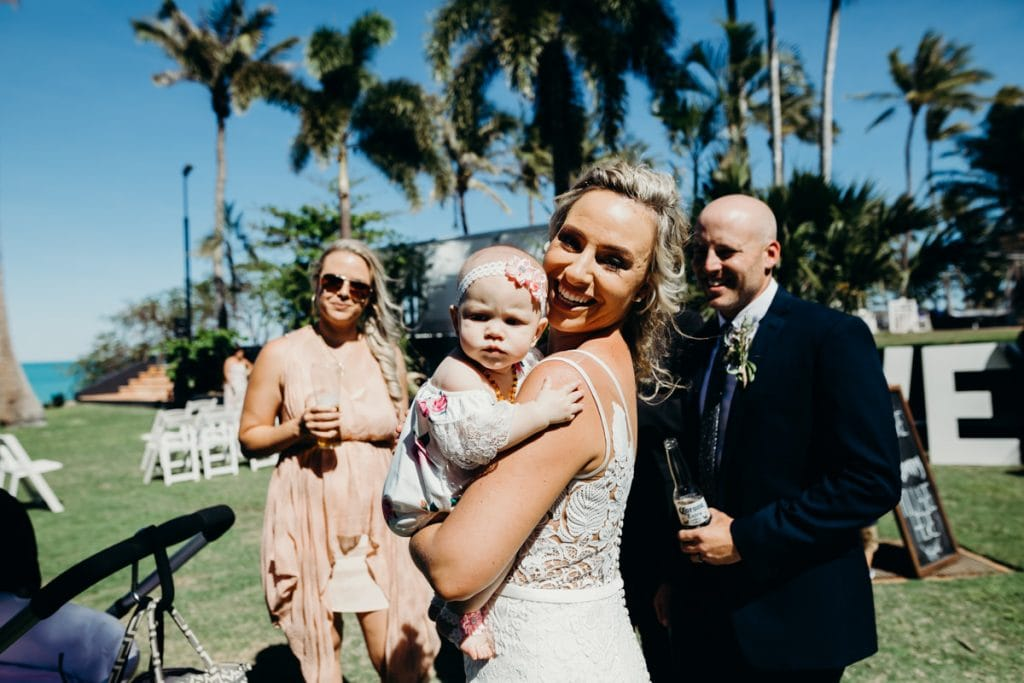 bride with small child in her arm