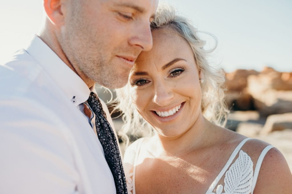 close up portrait of bride in groom's arms