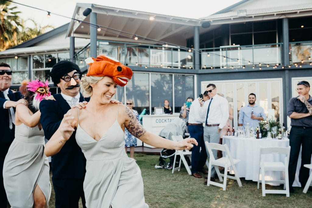 bridal party enter with funny costumes and dancing Broome wedding photographer at Mangrove Hotel wedding