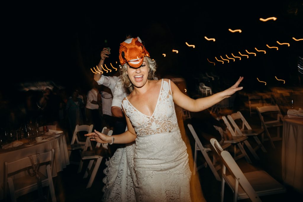 bride with horse head party costume at her wedding on Mangrove Hotel