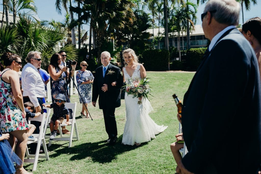 Bride and her grandfather walk down the aisle at Mangrove Hotel wedding in Broome Western Australia