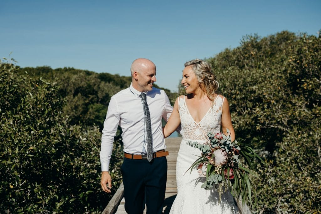 bride and groom at Streeter's Jetty in Broome