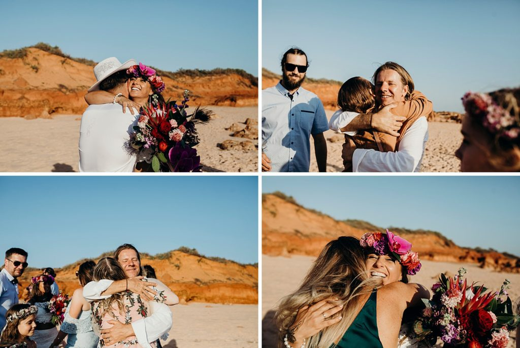 wedding guests congratulate a young couple and hug and kiss them